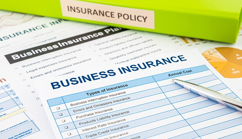 """""""Image of business insurance folders and documents"""""""