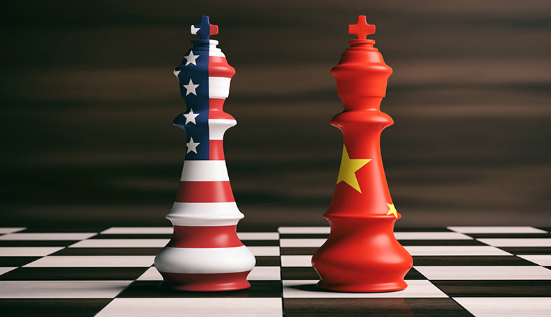 Illustration of two kings on a chessboard, one painted with the American flag, the other with the Chinese flag