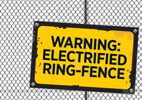 Yellow sign on fence, reading 'Warning: electrified ring-fence'