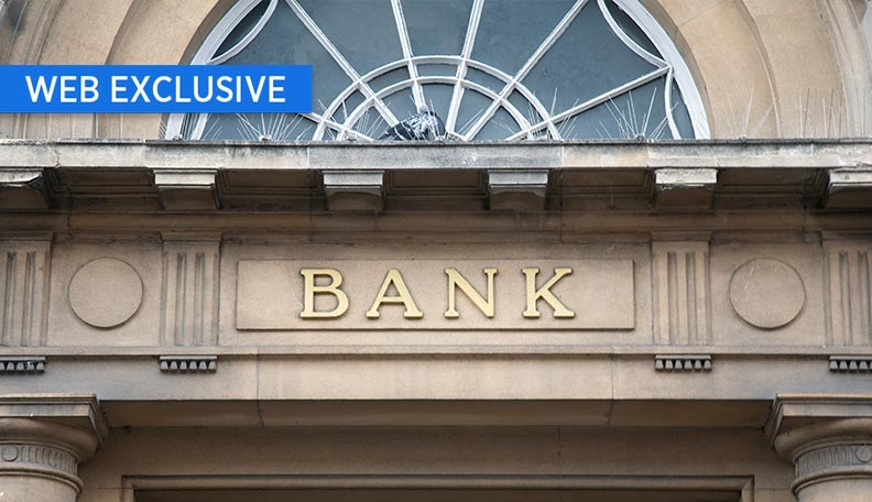 Image of a bank exterior, focusing on the word 'BANK' above the entrance