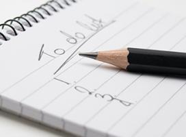 Image of a close-up of a to-do list on a notepad and with a pencil